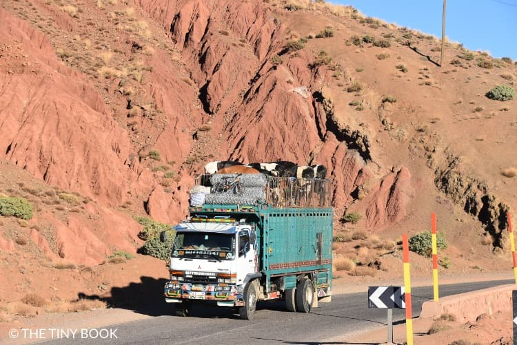 Morocco, truck crossing the Atlas mountain range.