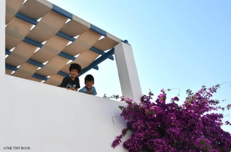 Kids in balcony, Kouros Village, Antipaso island, Greece.
