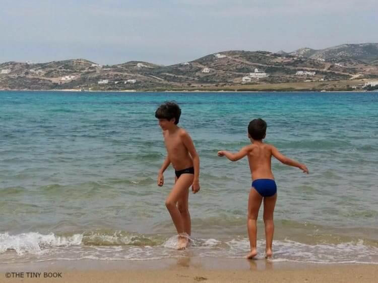 Kids on the beach, Antiparos island, Greece.